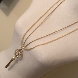 Long Gold and Pearl Pendant Necklace
